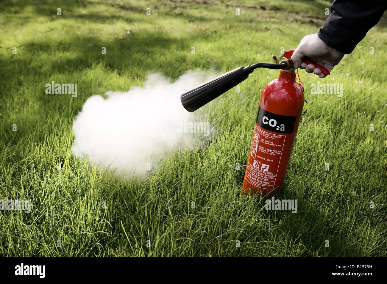 Red C02 fire extinguisher in action - Stock Image