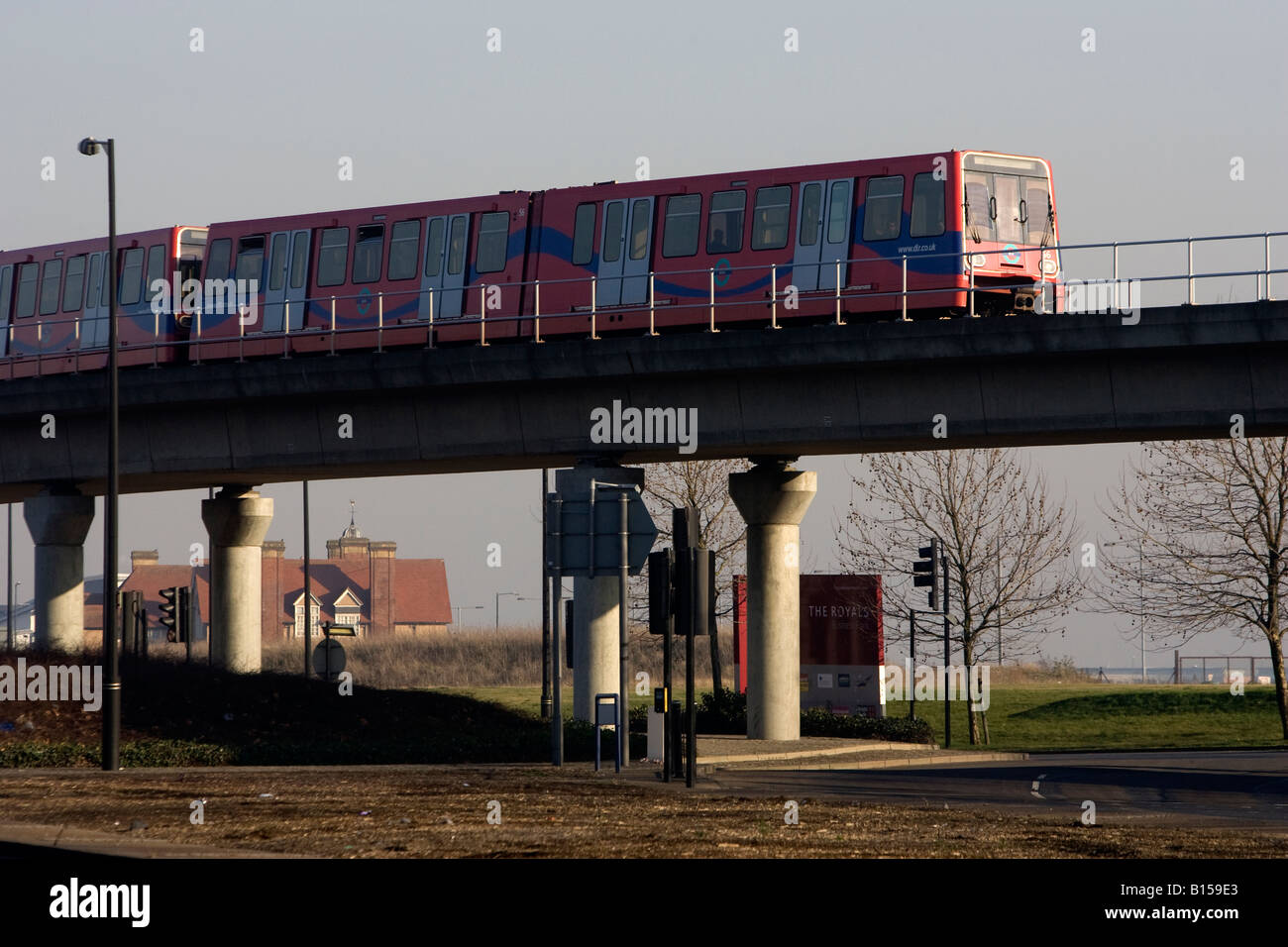 One of the trains of the Docklands Light Railway London over a bridge in the Docklands - Stock Image