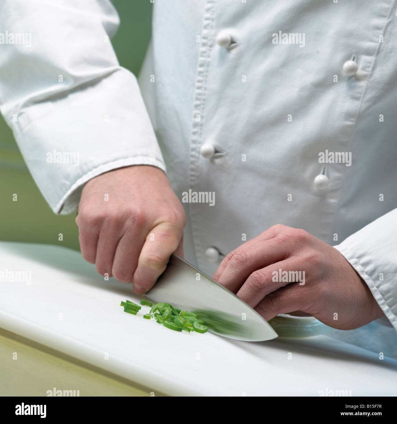 cook is cutting leek close up hands and knife Stock Photo