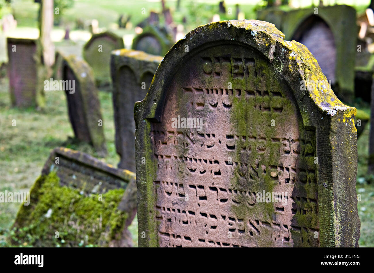 Hebrew writing on gravestone in Jewish cemetery the Alter Judenfriedhof or Herliger Sand Worms Germany - Stock Image