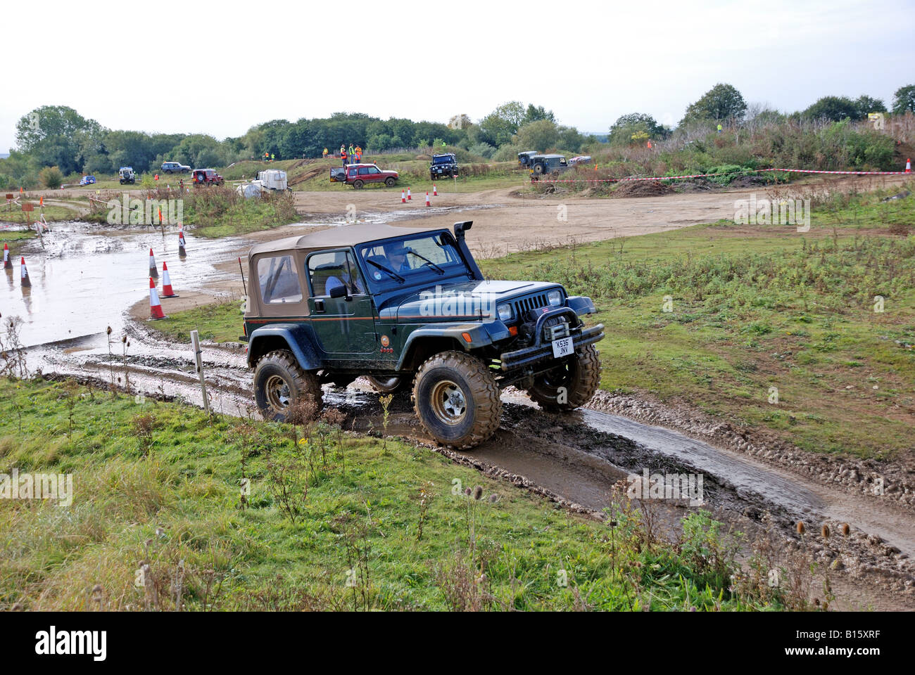 Owner tries off roading in a left hand dive Jeep Wrangler fitted with a raised air intake snorkel a winch and a - Stock Image