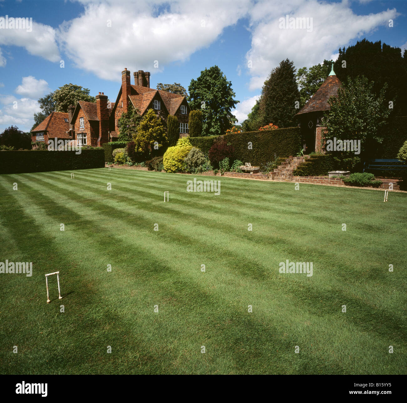 Croquet lawn in the gardens of a large country house Kent England UK. - Stock Image