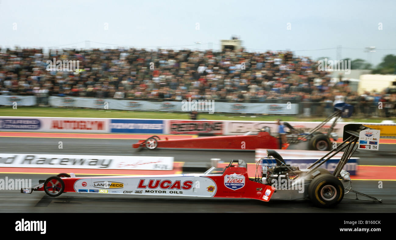 Top Fuel dragsters Driven by Andy Carter (nearside). Santa Pod raceway England UK. - Stock Image