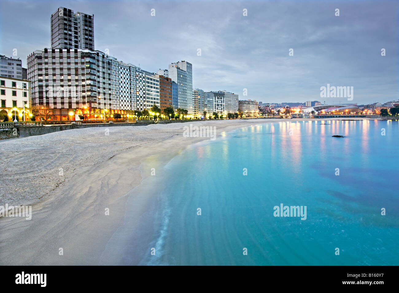 Dawn view of the Playa de Orzan beach in the town of La Coruña in Spain's Galicia region. - Stock Image