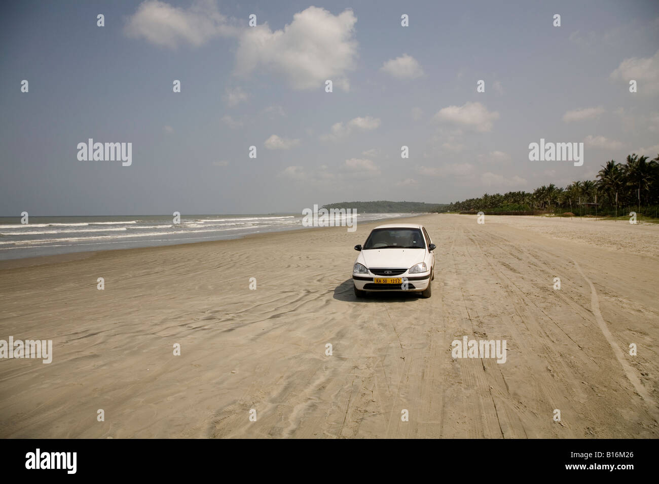 A car dives on Muzhappilangad Drive In Beach near to Thalassery in Kerala. It is India's only drive in beach. - Stock Image