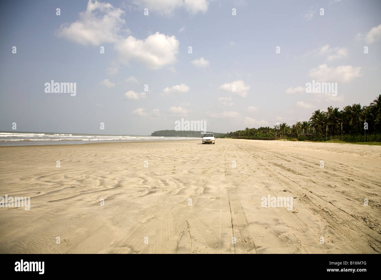 A car drives on Muzhappilangad Drive In Beach near to Thalassery in Kerala. It is India's only drive in beach. - Stock Image