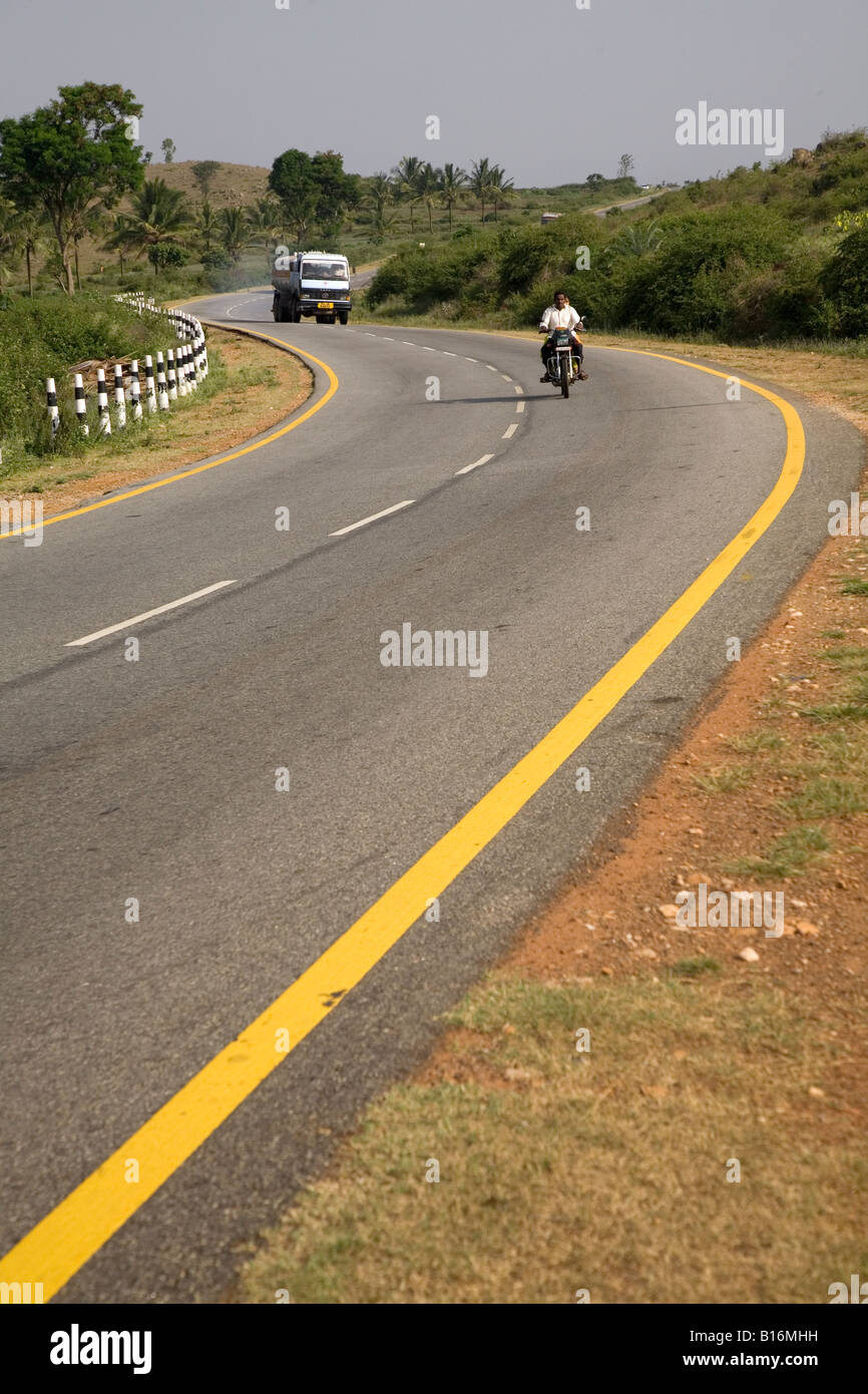 The smooth curves of State Highway 57 in Karnataka. The road can be found near Hassan. - Stock Image