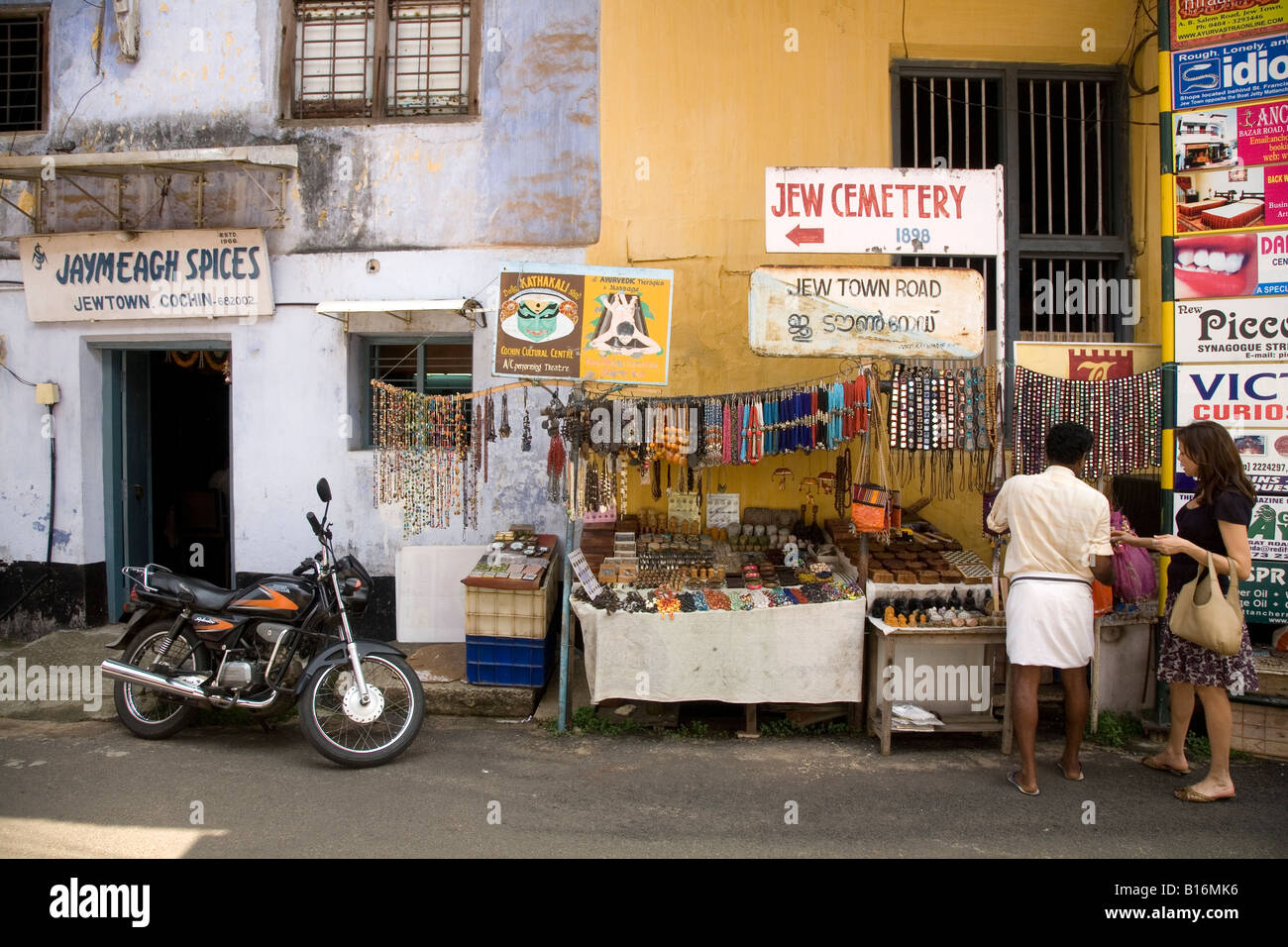 A woman visits a stall in Jew Town Road, the lane that leads towards the synagogue in Jew Town, Kochi. - Stock Image