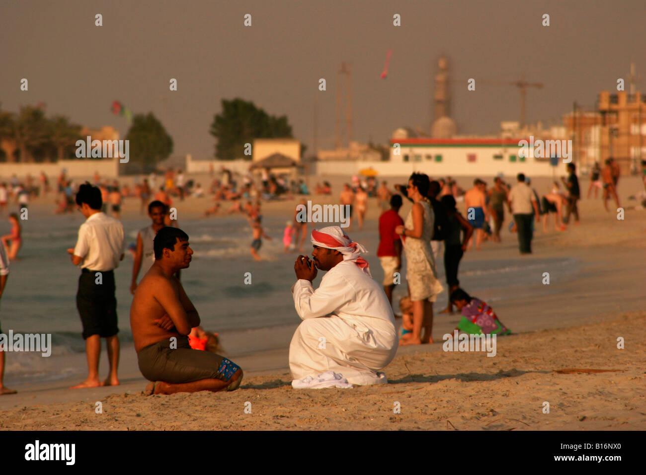 locals talking at the Jumeirah Beach Club in Dubai United Arab Emirates UAE - Stock Image