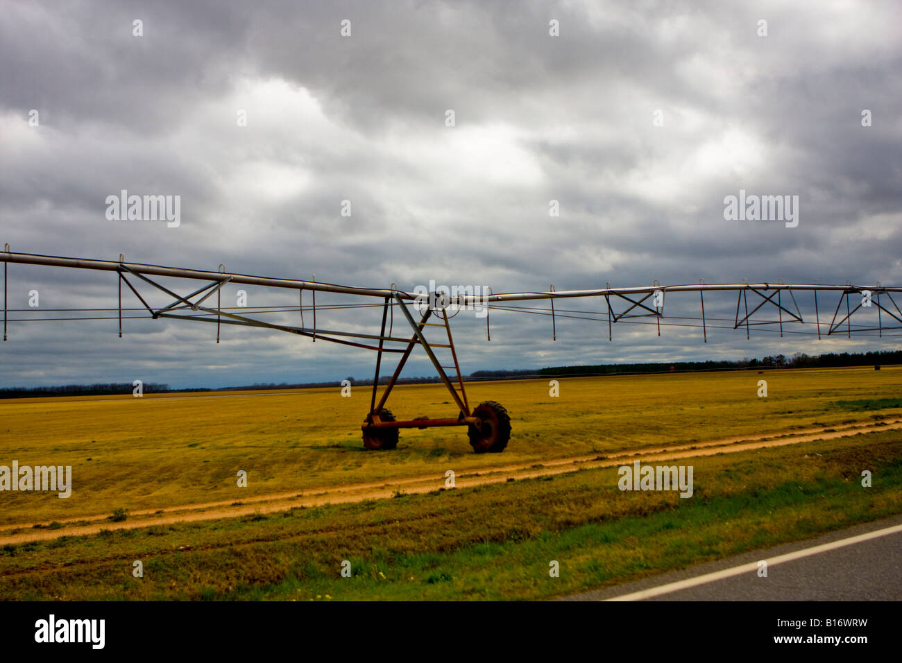 Farm Field and a Center Pivot Irrigation System - Stock Image