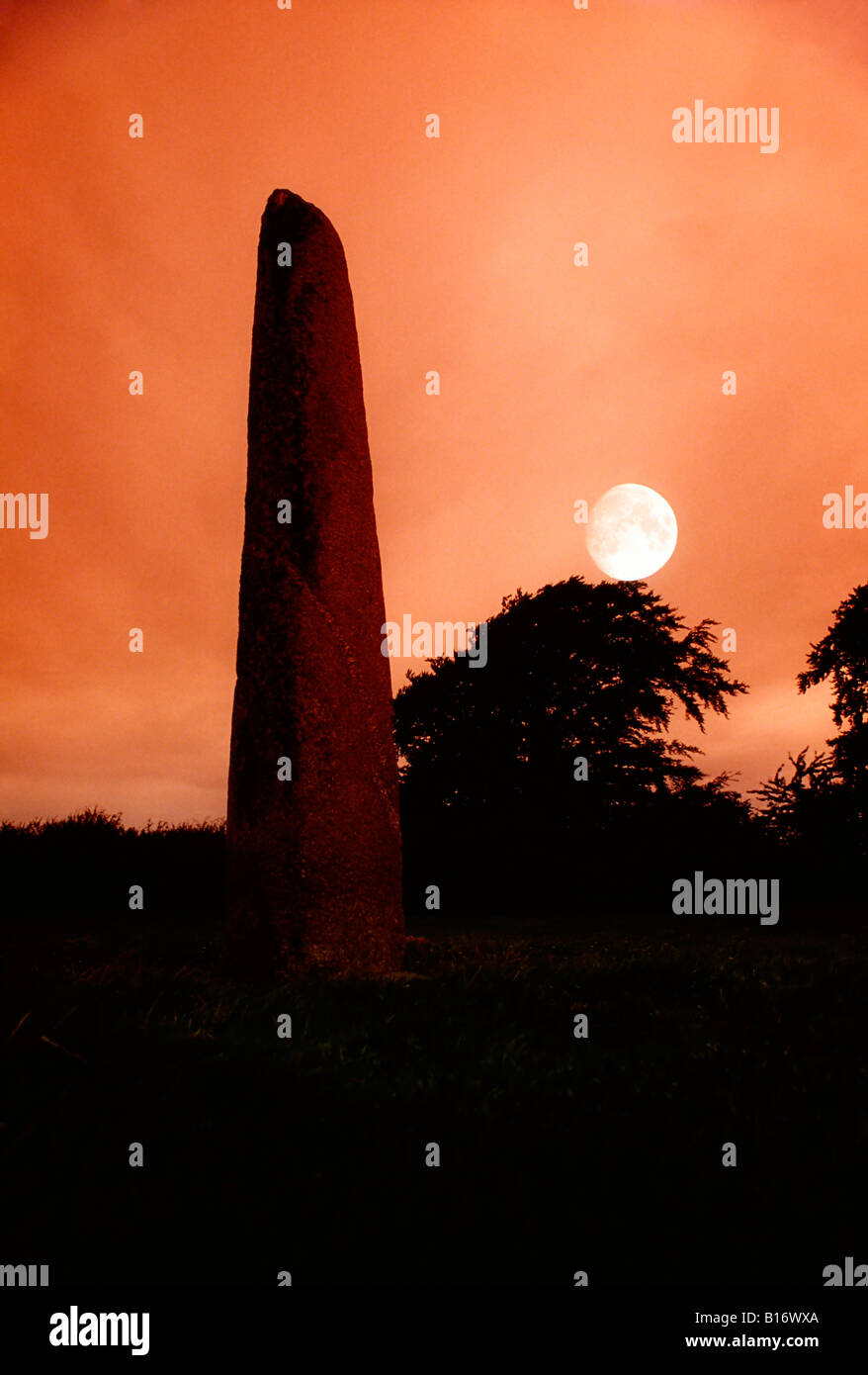 Standing stone with moon, Punchestown, Co Kildare, Ireland Stock Photo