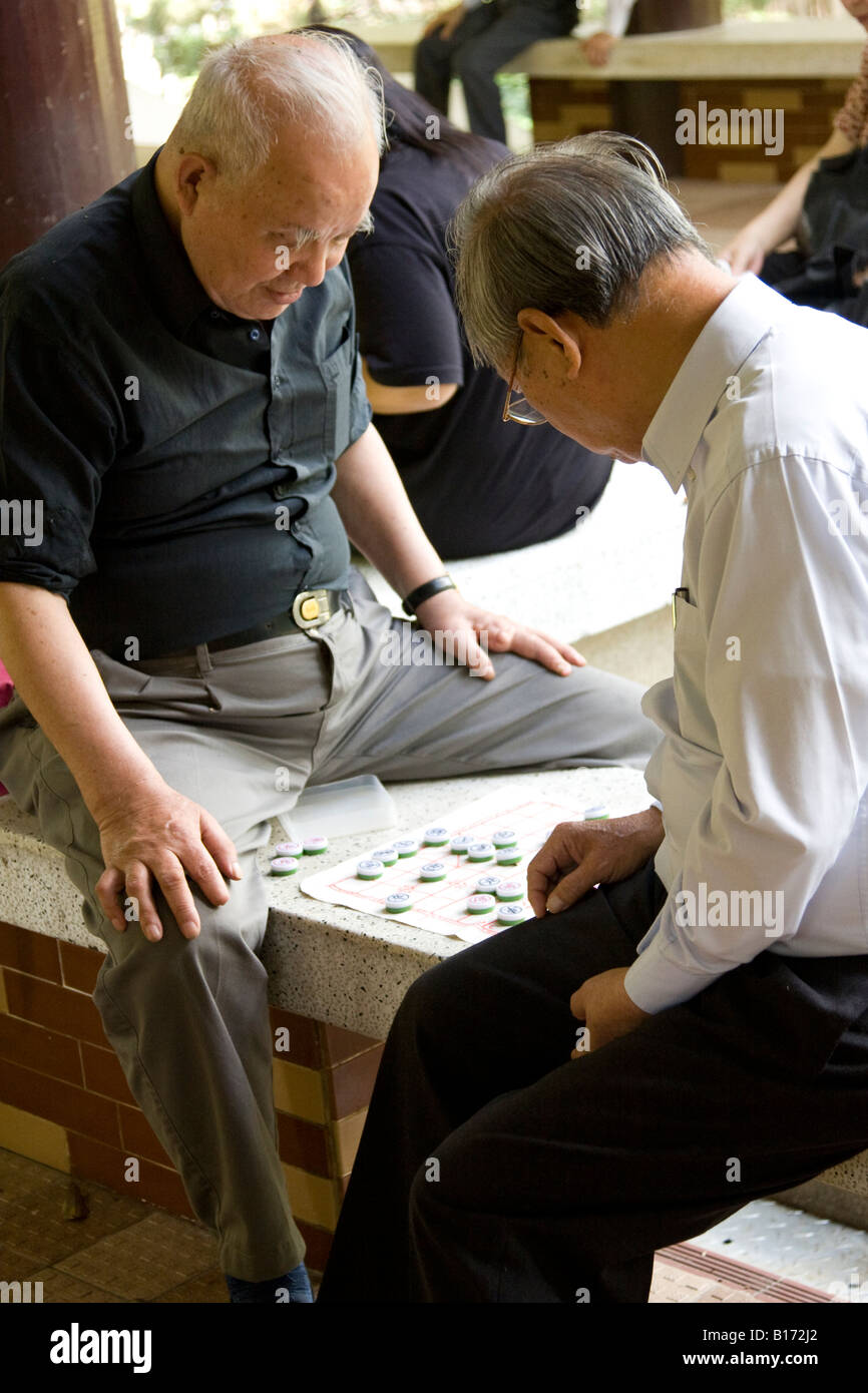 Men Playing Chinese Chess in Park in Kowloon Hong Kong Stock Photo