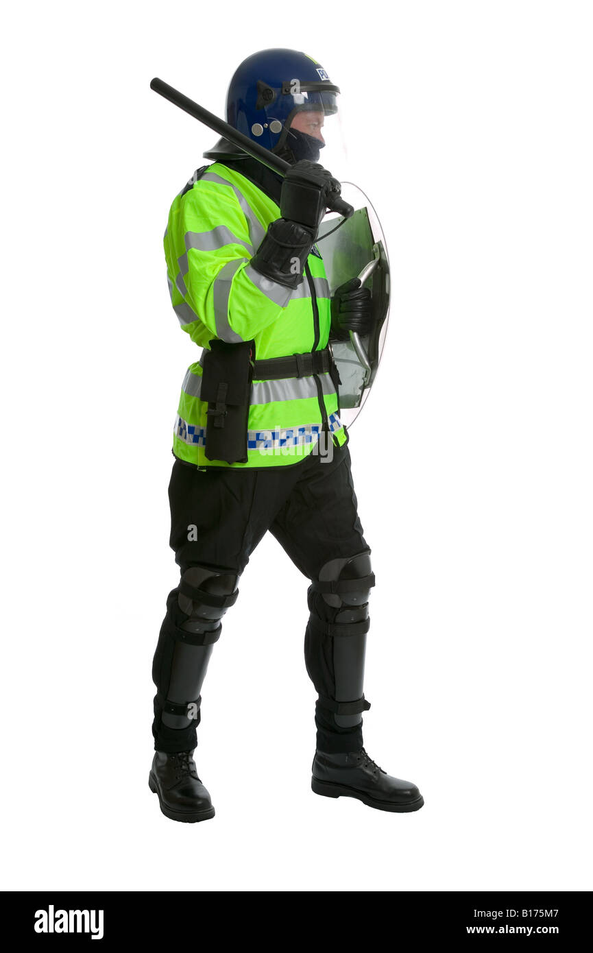 Side profile of a Police officer in full riot gear holding a shield with his baton raised shot against a white background - Stock Image
