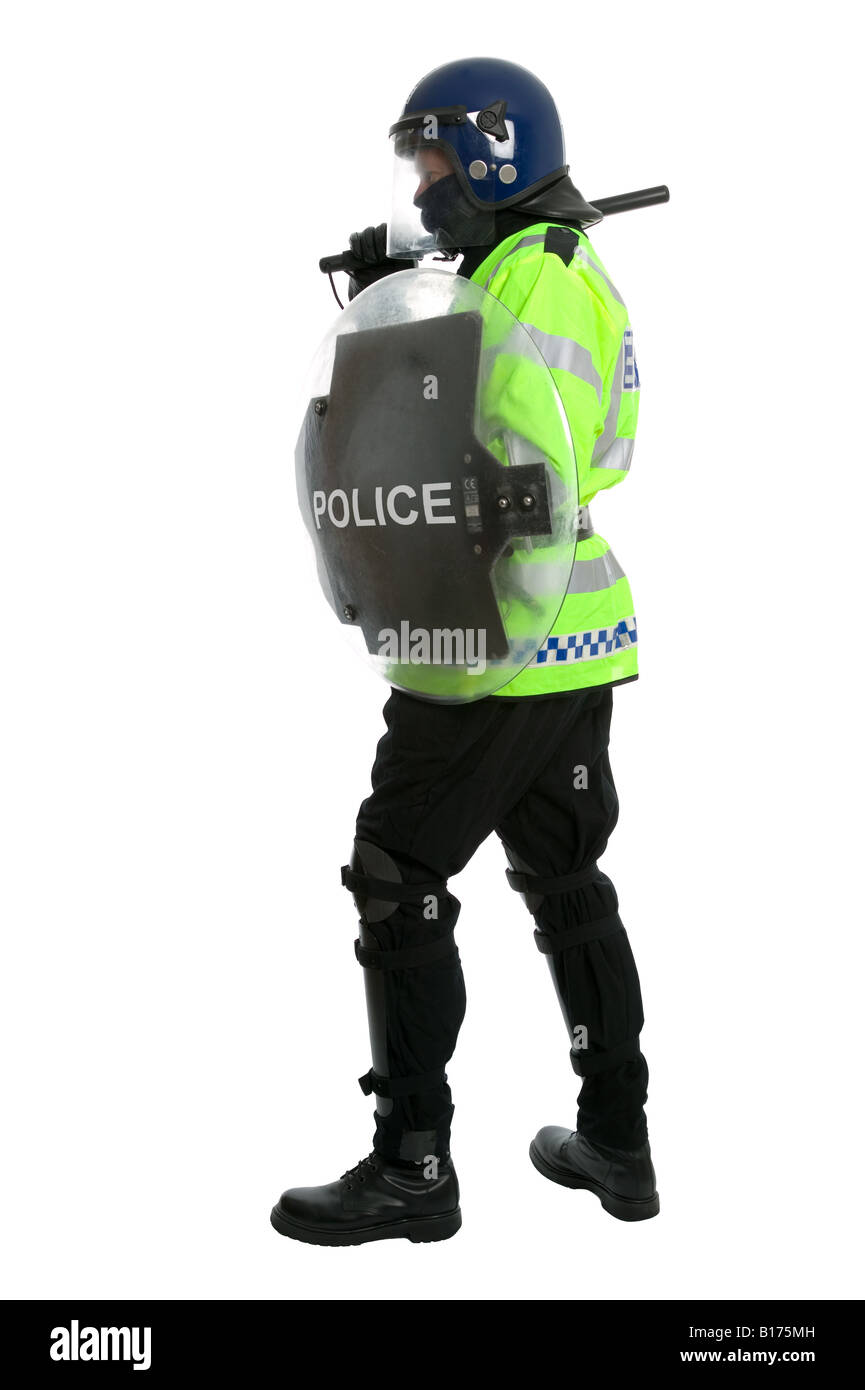 Police officer in full riot gear with his baton raised and carrying a shield shot against a white background - Stock Image