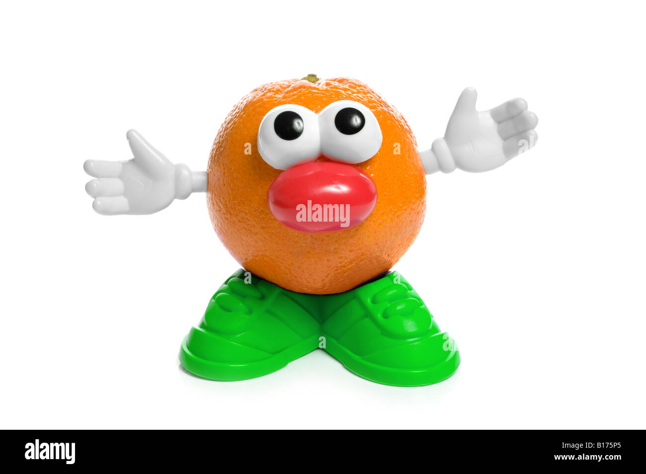 An orange with body parts - Stock Image