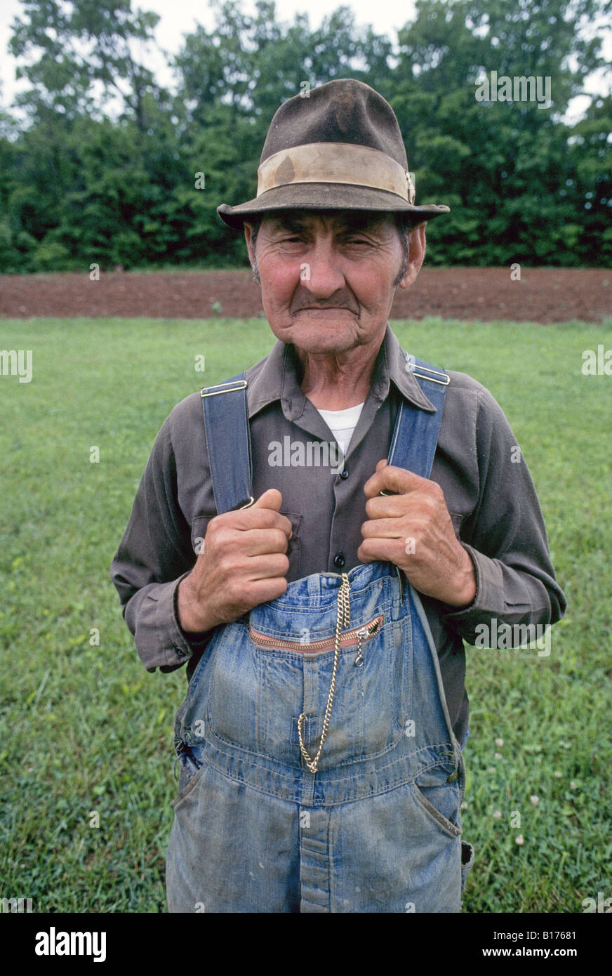 A moonshine maker and farmer in Franklin County Virginia wears overalls - Stock Image