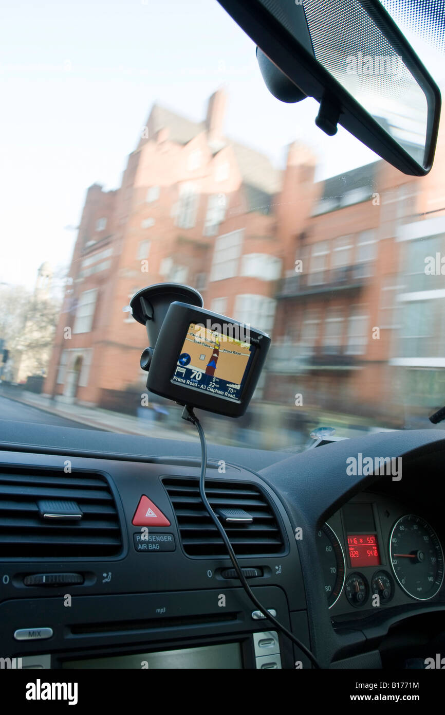 Tomtom GPS satellite navigation device in use in a car - Stock Image