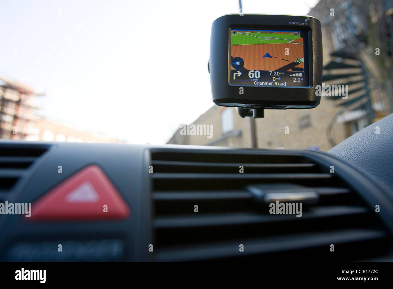 Tomtom GPS satellite navigation device in use in a car Stock