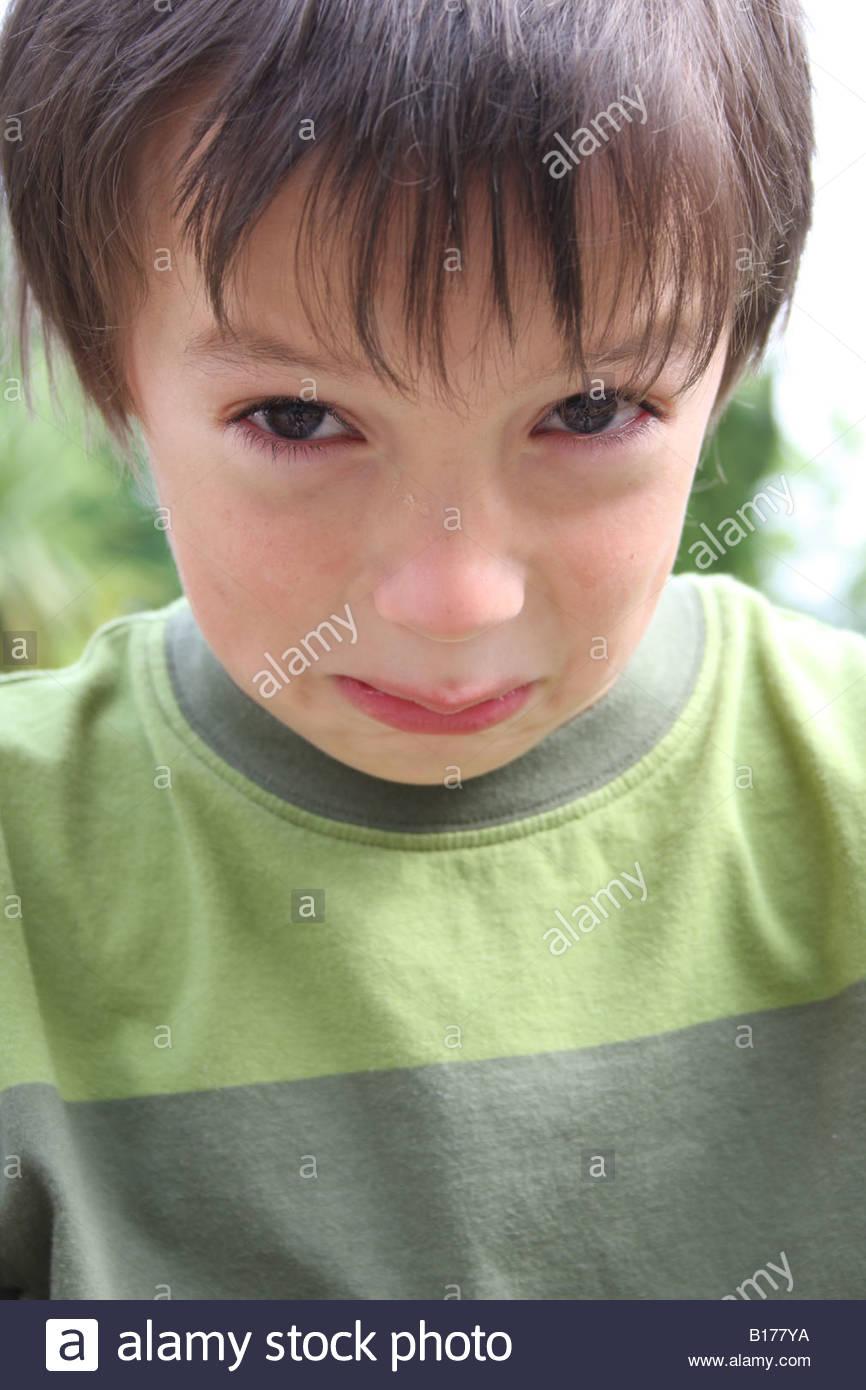 A boy in tears - Stock Image