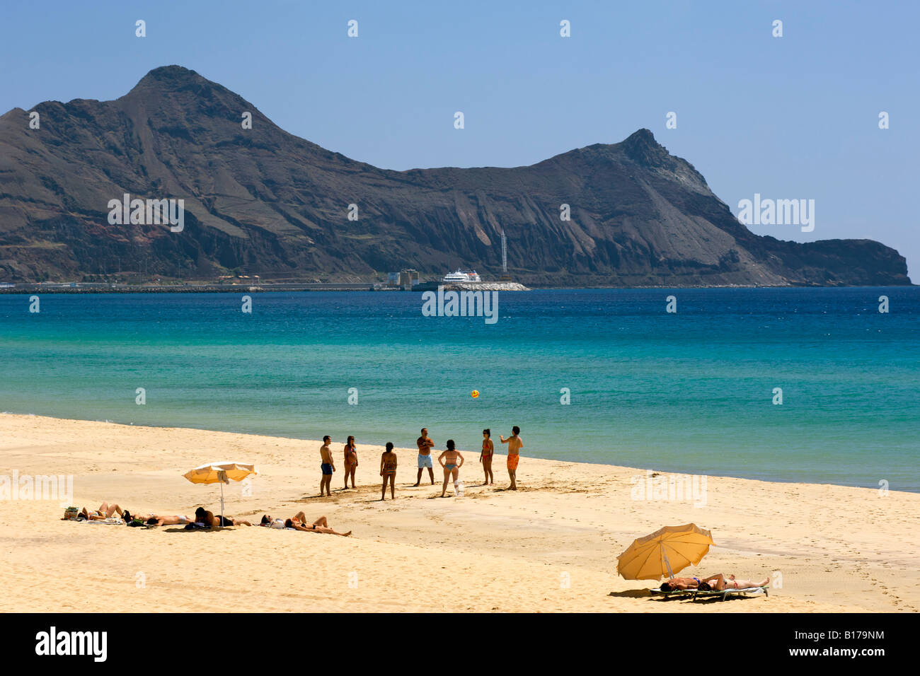 People playing ball on the beach of the Portuguese Atlantic island of Porto Santo. - Stock Image