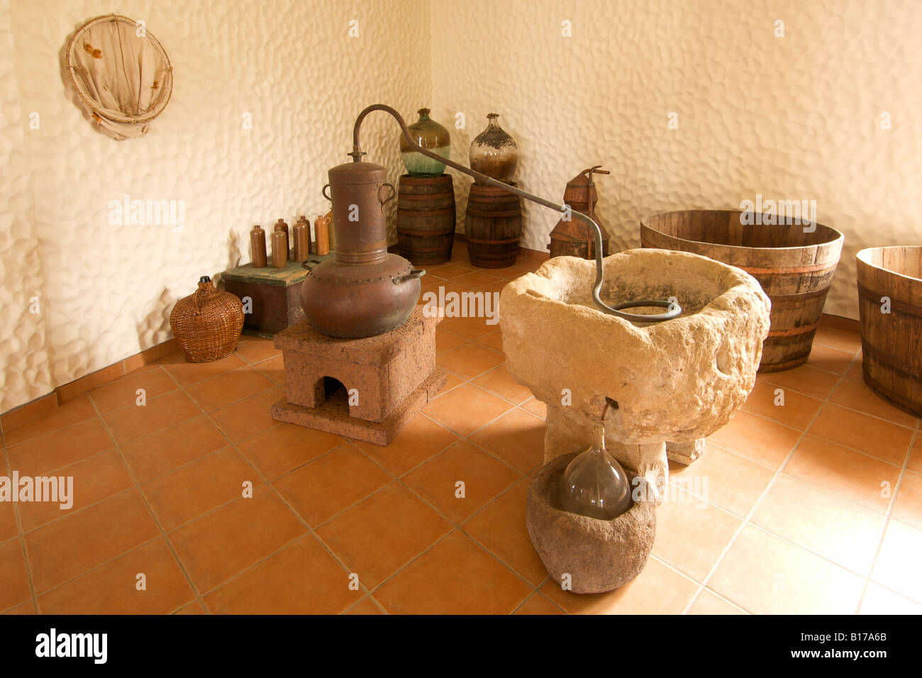 Distilling equipment in the Museu do Cardina museum on the Portuguese Atlantic island of Porto Santo. - Stock Image