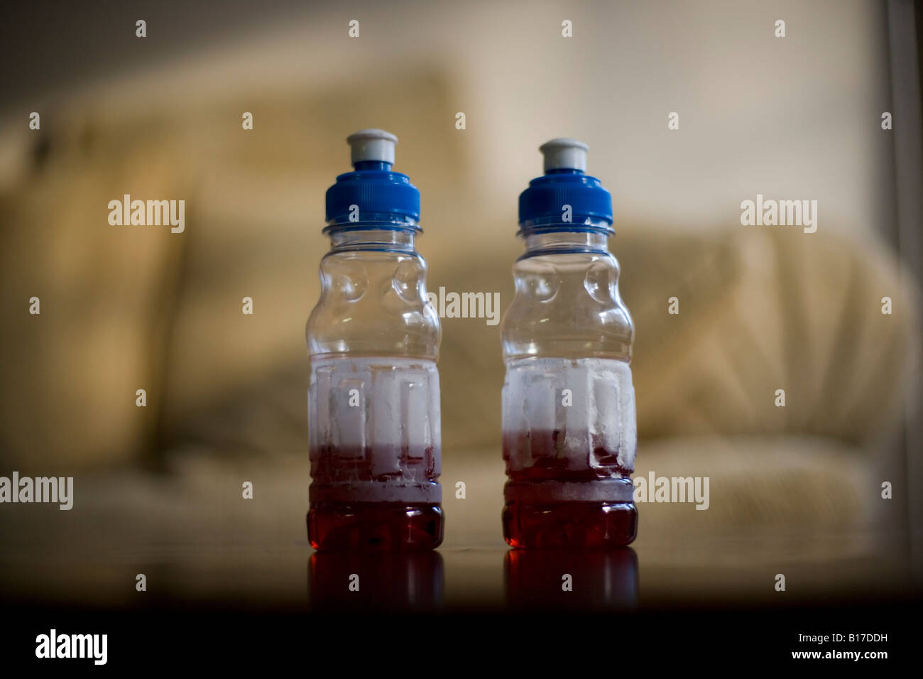 Plastic drinks bottles from Burger King reused and put to use in the family home as spill proof bottles for the - Stock Image