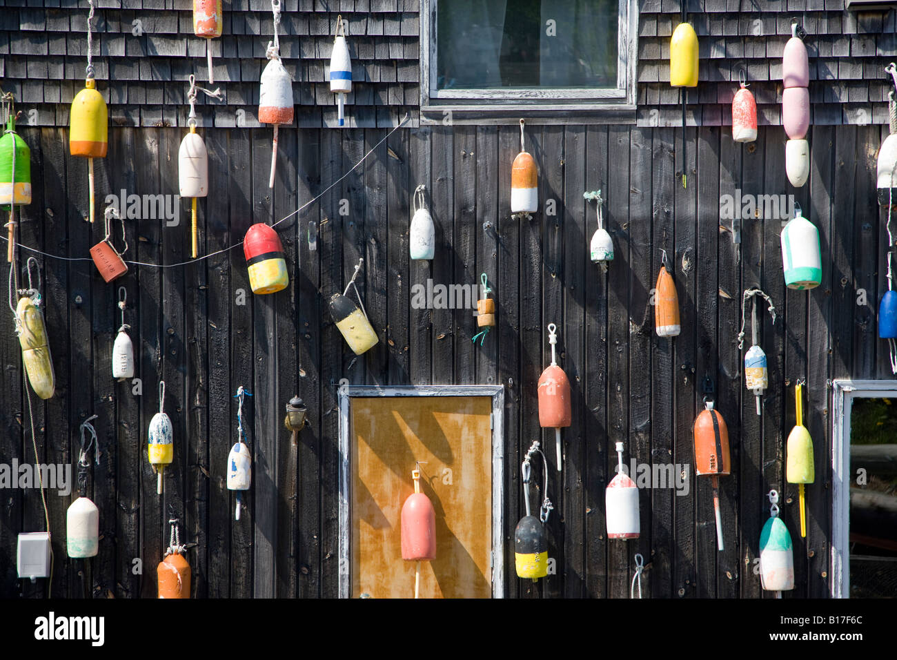 Lobster buoys decorate the Stewman's Downtown restaurant on the city pier, Bar Harbor, Maine, USA - Stock Image