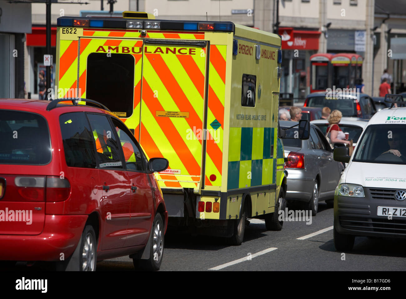 northern ireland ambulance service emergency ambulance sitting in middle of traffic downpatrick county down northern - Stock Image