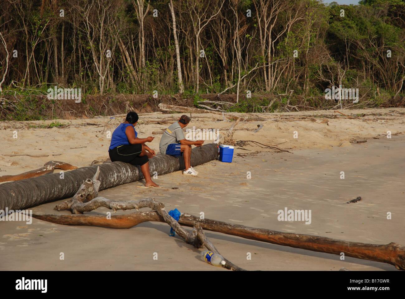 married couple amerindian fishing with fishing line - Stock Image