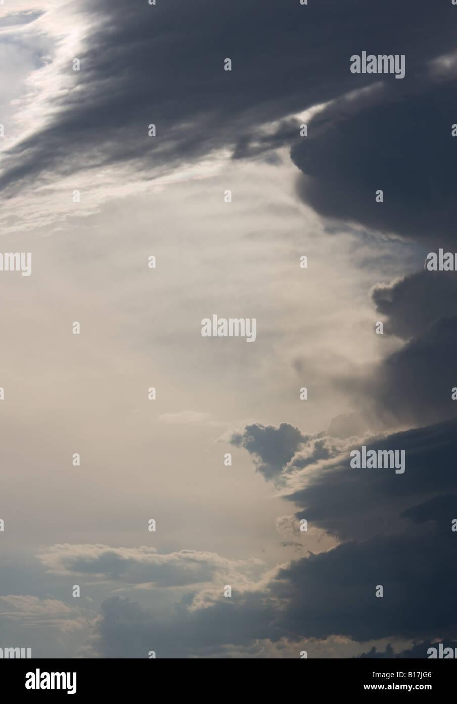 Evening cumulonimbus clouds with developing thunderstorm - Stock Image