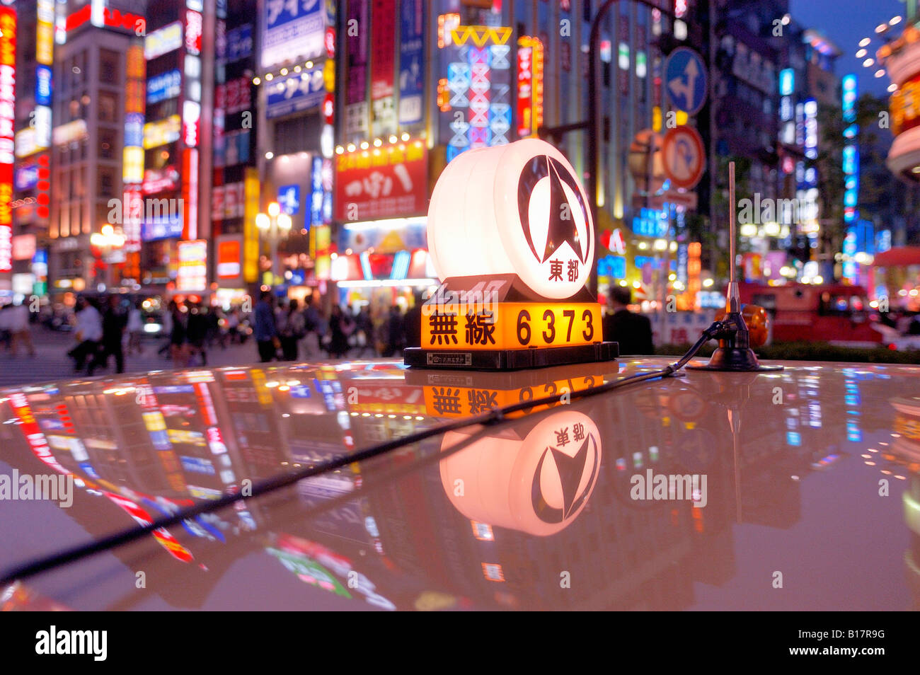 roof of a taxi and neon lights Shinjuku Tokyo Japan - Stock Image