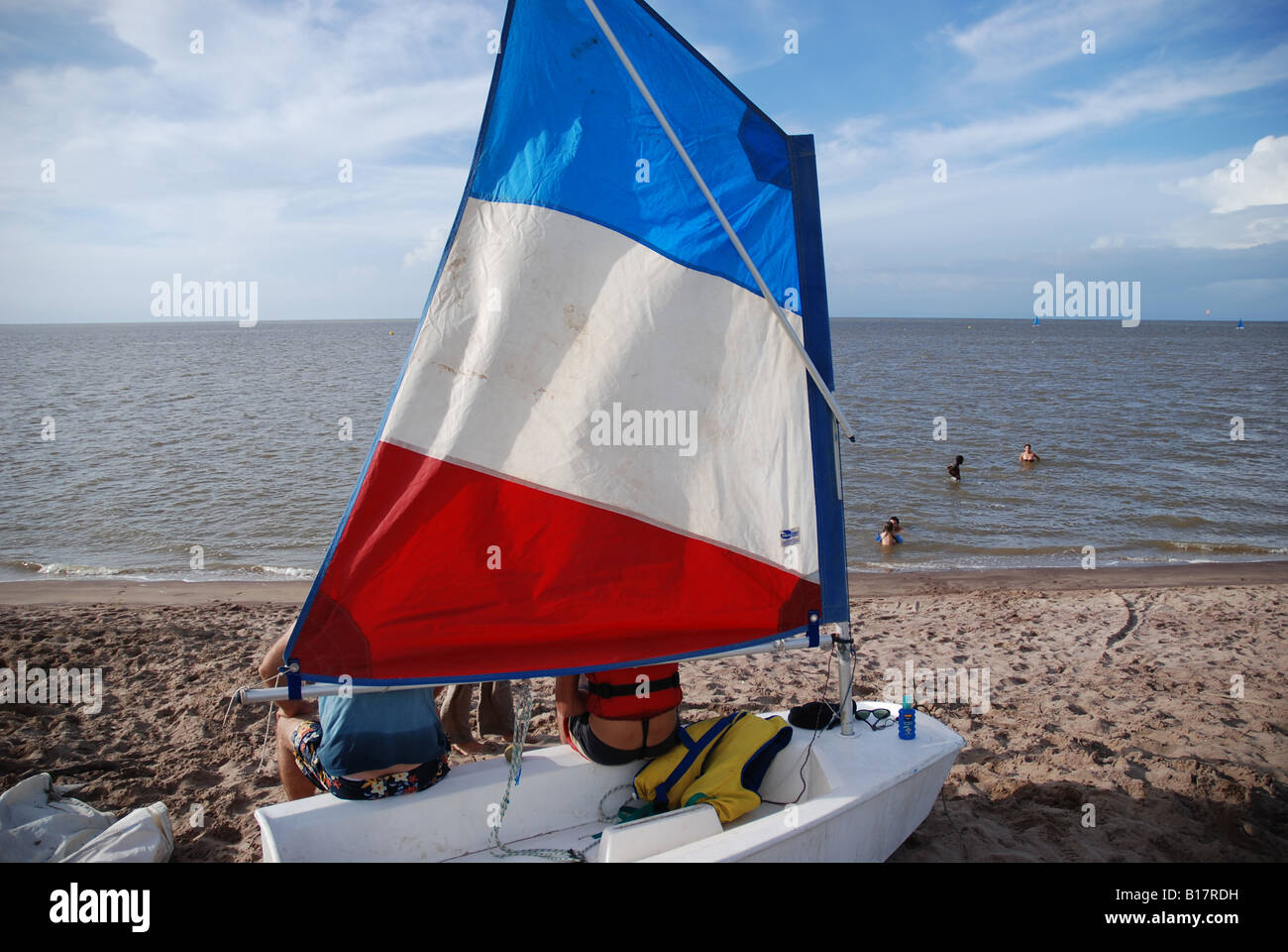 french flag sail on a sailing boat on the beach - Stock Image