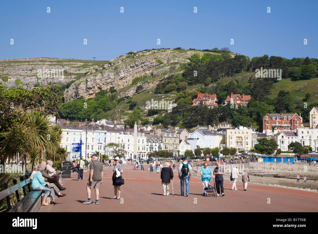 People strolling on North Parade promenade on seafront in elegant 19th century Victorian seaside holiday resort. - Stock Image