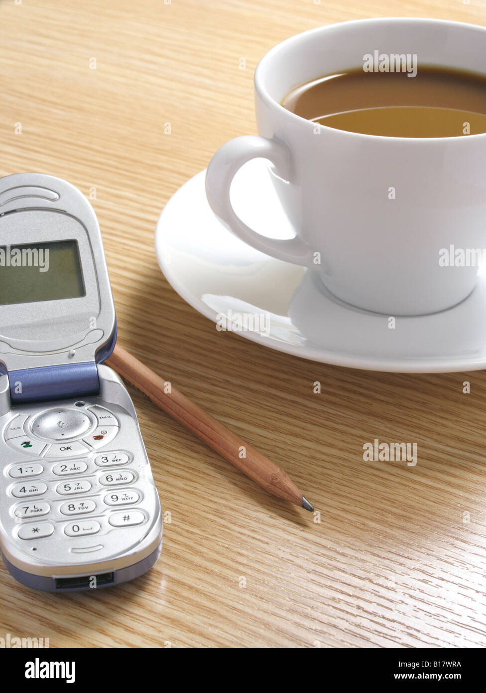 Coffee Pencil and Cellphone on Desk Stock Photo