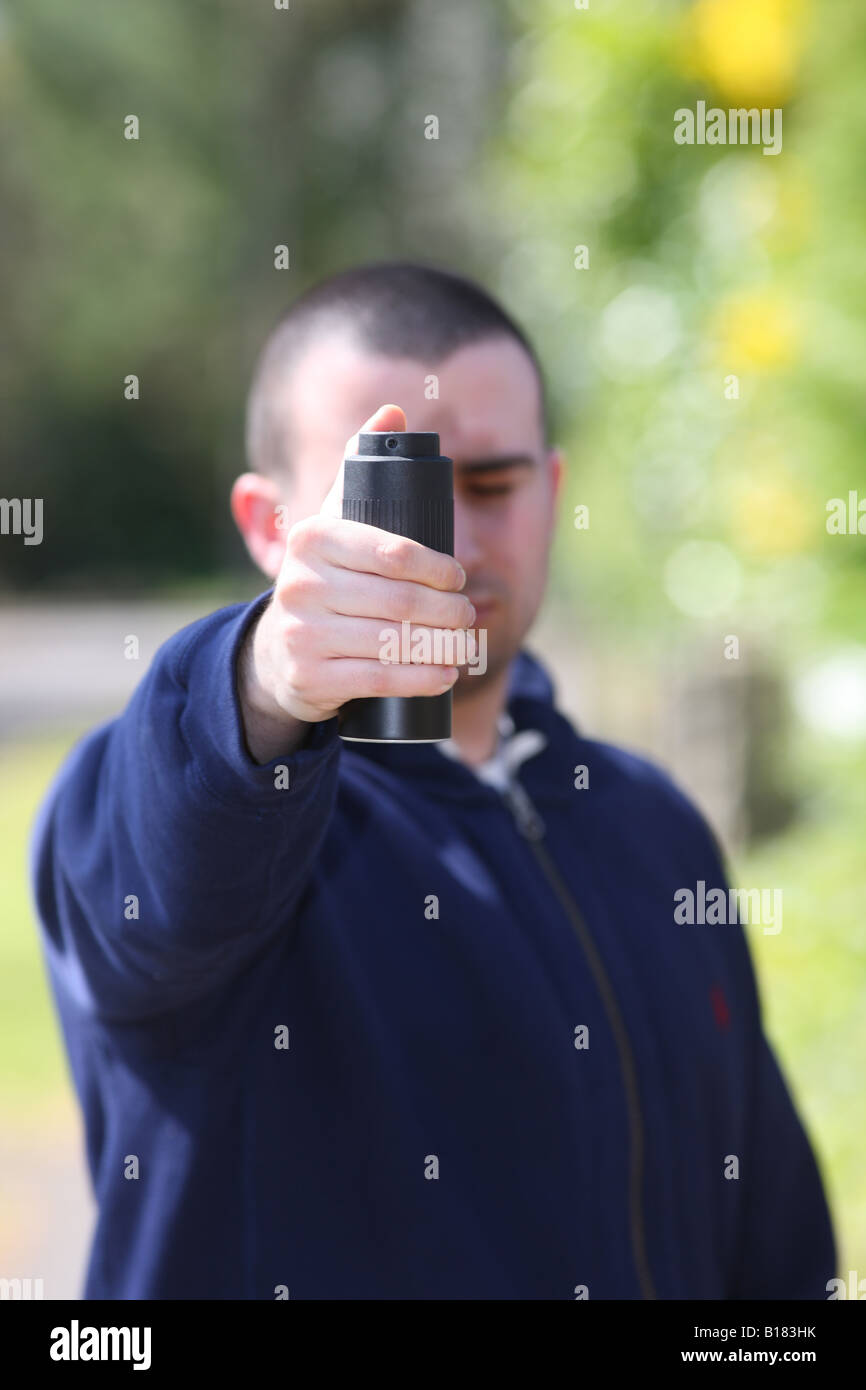 Man Spraying CS Gas Model Released - Stock Image