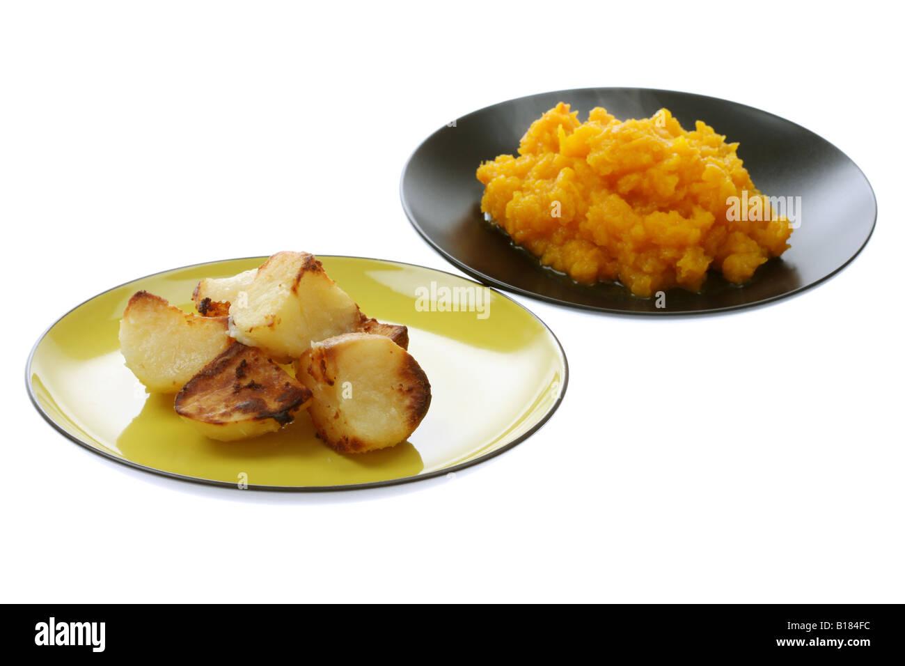 Roast Potatoes and Mashed Butternut Squash - Stock Image