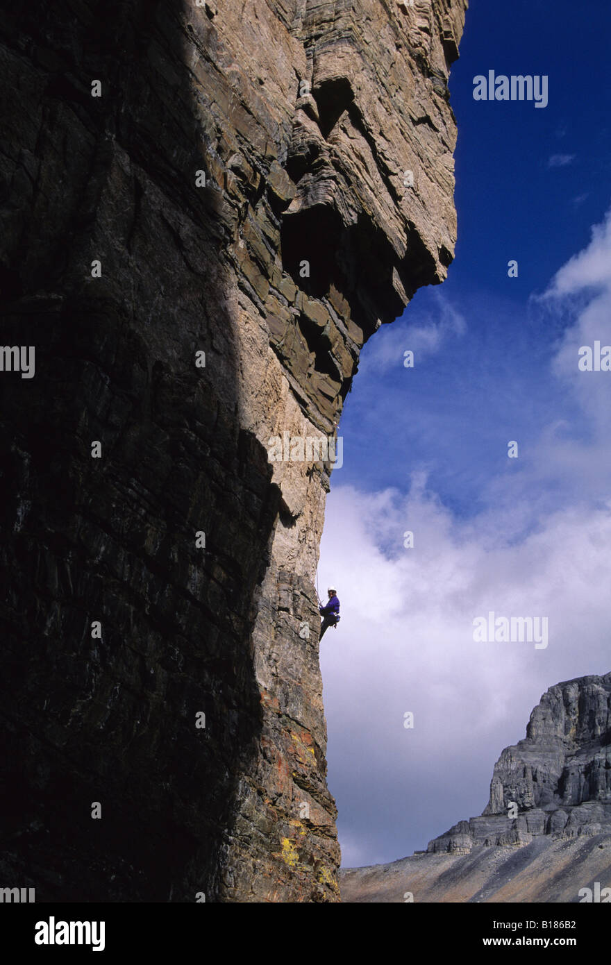 Climbers on the route Cardiac Arete The Grand Sentinel Banff National Park, Alberta, Canada. - Stock Image