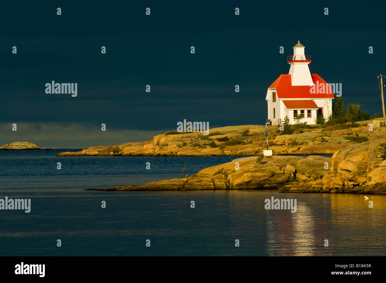 Snug Harbour lightstation on a stormy morning, Georgian Bay, Ontario, Canada - Stock Image