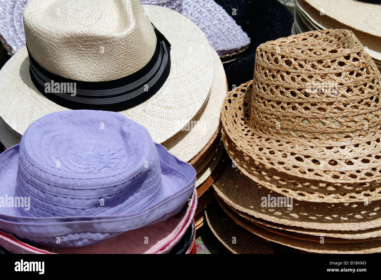 7f7225e77e44a selection of straw hats on outdoor market stall Stock Photo ...
