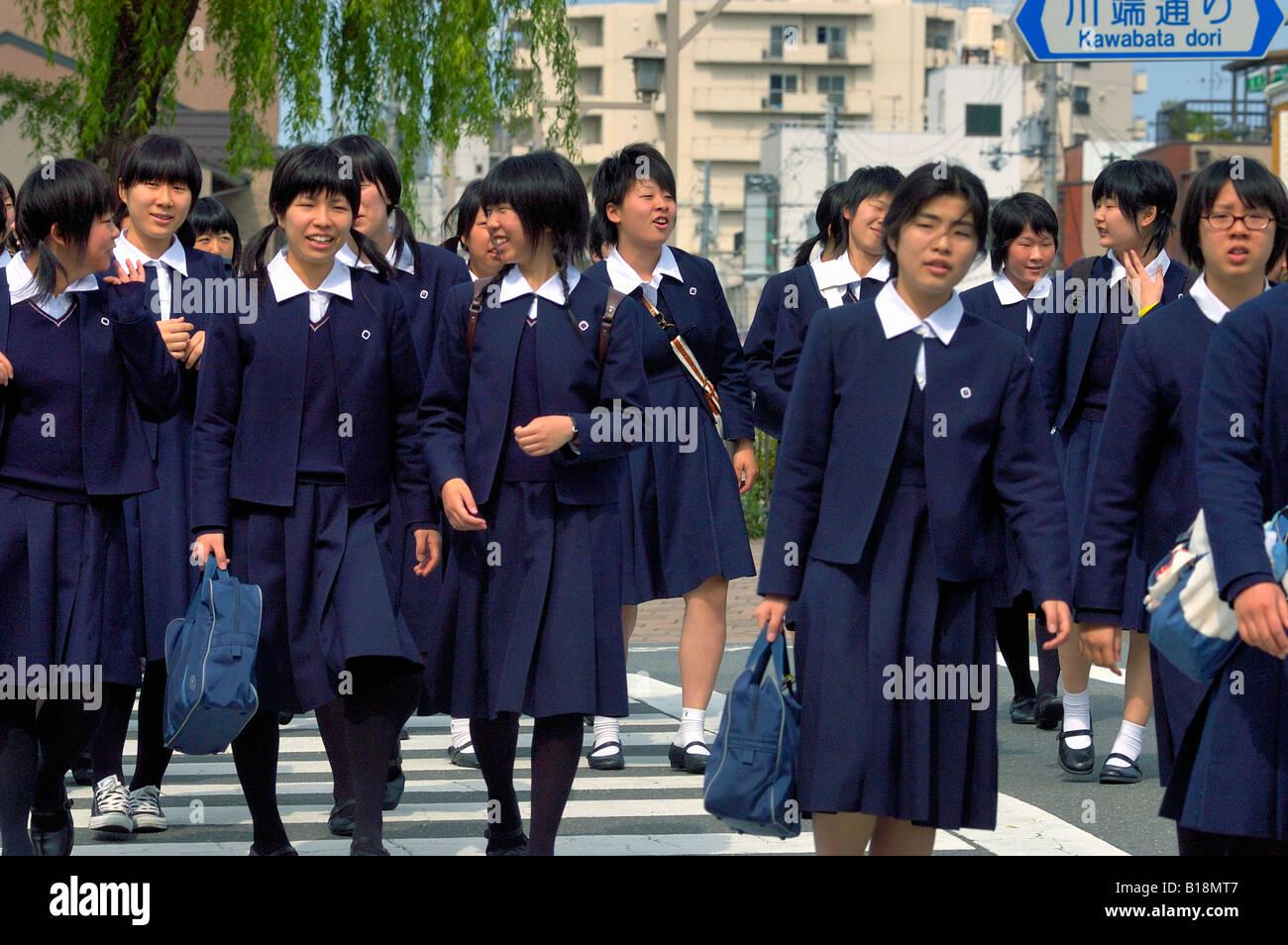 Girls At Crosswalk In School Uniform Kyoto Japan Stock Photo