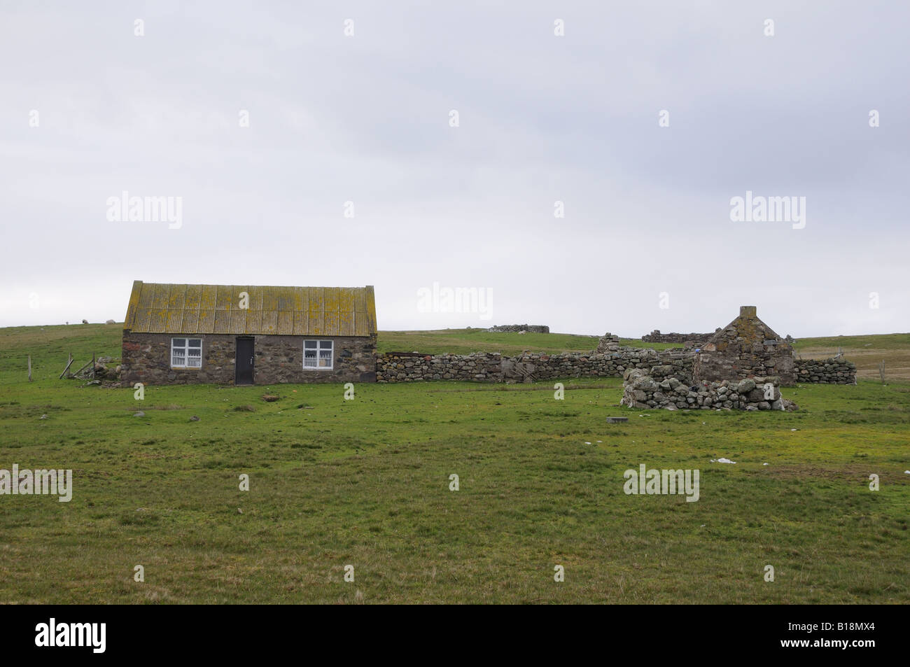 Shetland croft. In Shetland, people use stones as their primary building material. There are almost no trees. - Stock Image