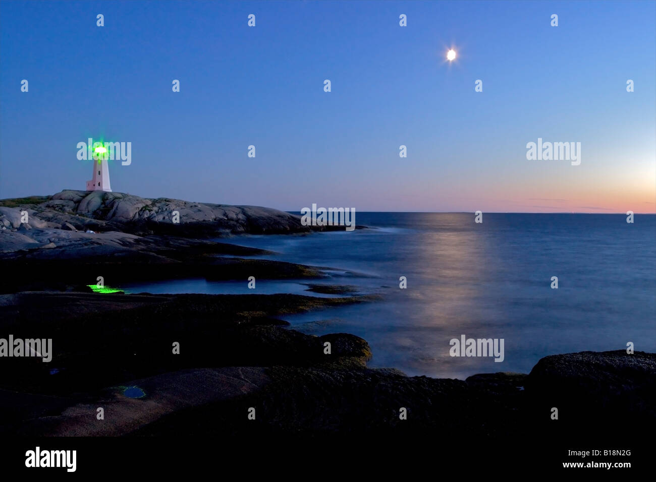 Peggy's Cove Ligthhouse and moon during blue hour, Peggy's Cove, St Margarets Bay, Lighthouse Route, Highway - Stock Image