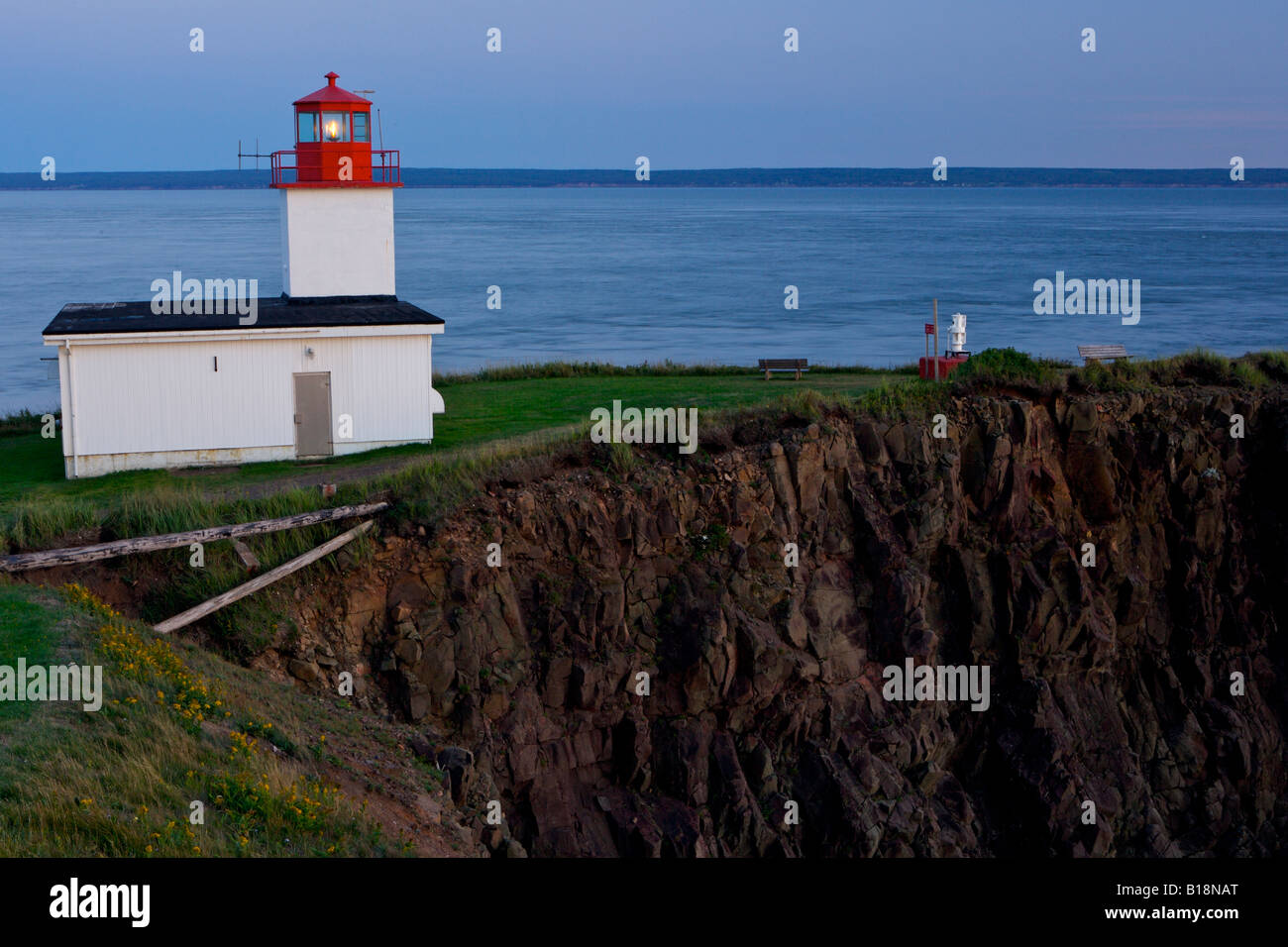 Cape d'Or Lighthouse at blue hour, Cape d'Or, Cape Chignecto, Bay of Fundy, Fundy Shore Ecotour, Glooscap - Stock Image