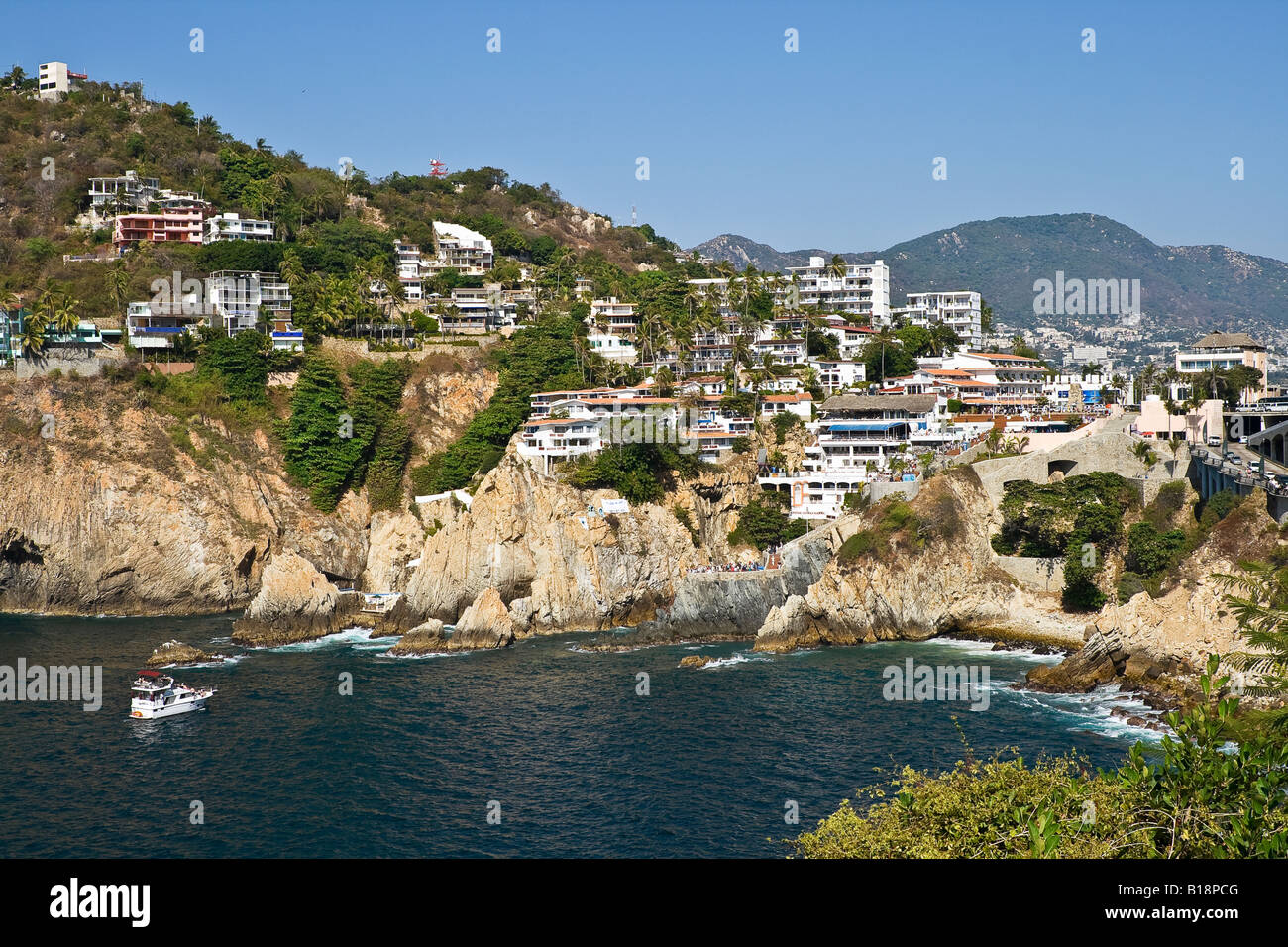 Cliffs from which jump divers that are renowned for their agility, La Quebrada, Acapulco, Guerrero, Mexico. - Stock Image