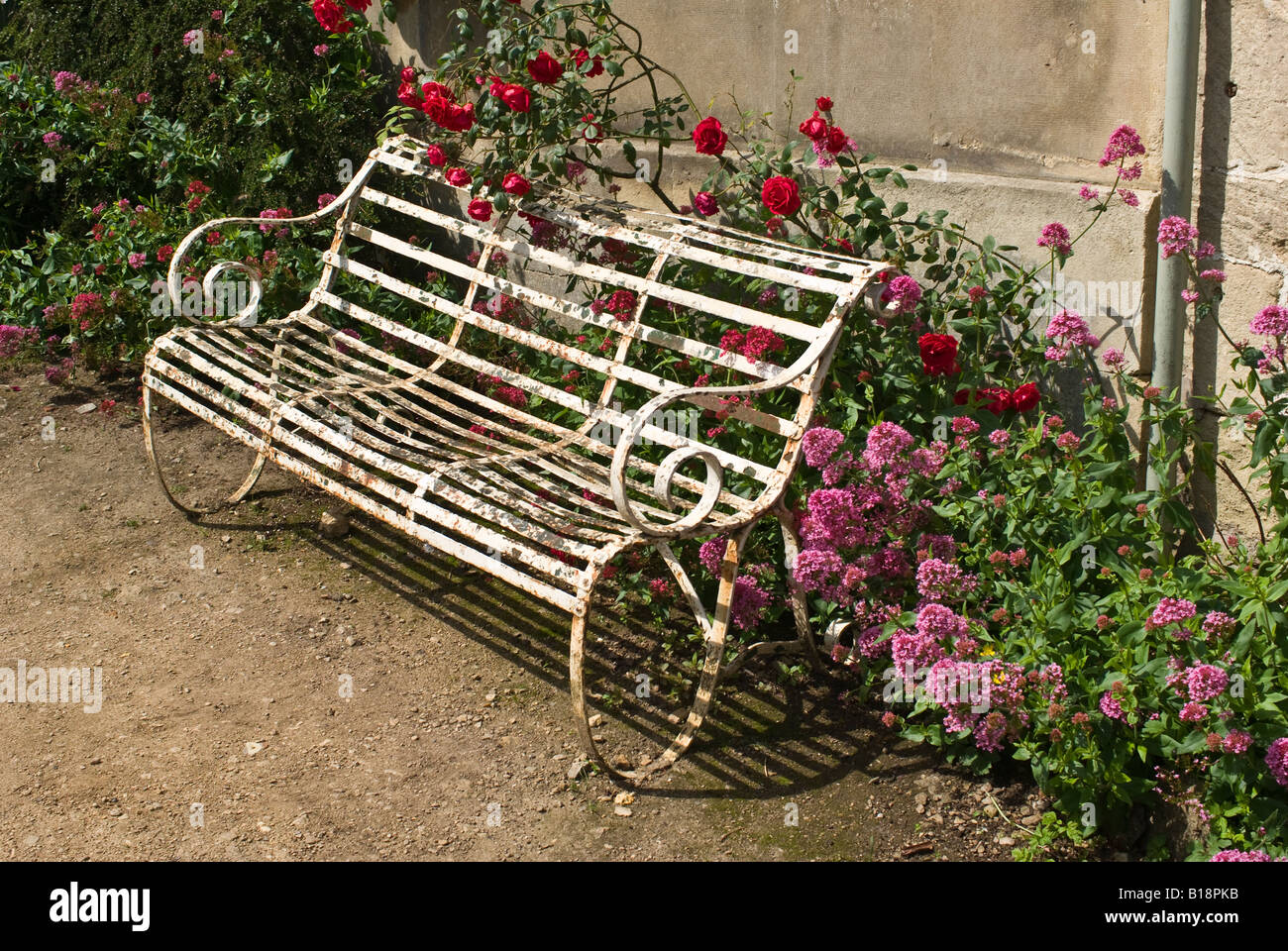 Superb Garden Wrought Iron Bench Stock Photos Garden Wrought Iron Gmtry Best Dining Table And Chair Ideas Images Gmtryco