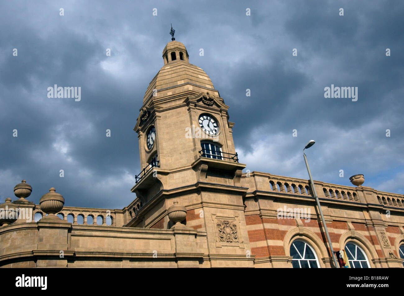 The red brick facade and clock tower of Victorian Leicester London Road Midland Railway Station opened in 1840 - Stock Image
