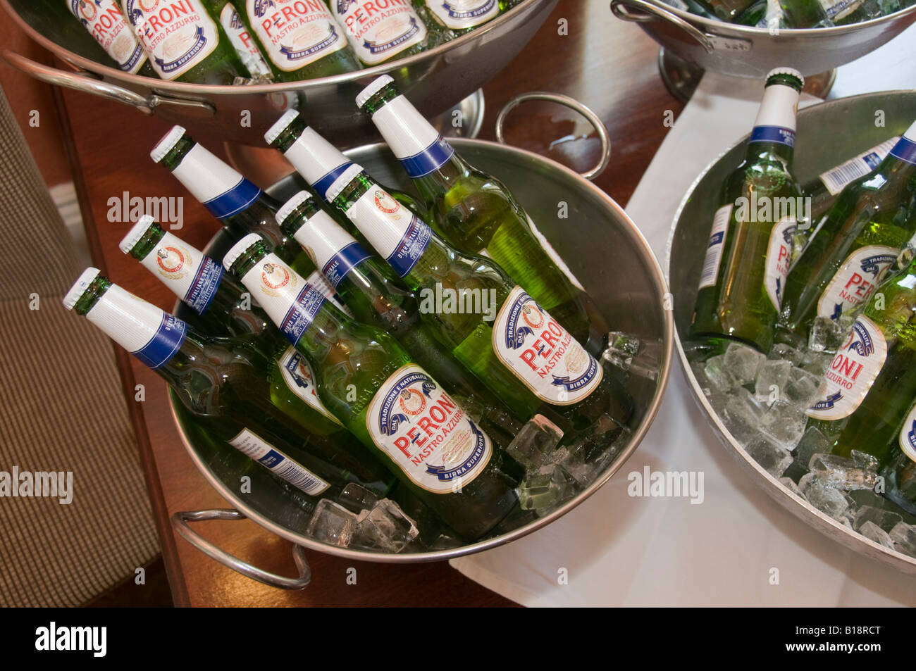 Bottles Of Peroni Beer Cooling In Buckets Of Ice At A Wedding Stock