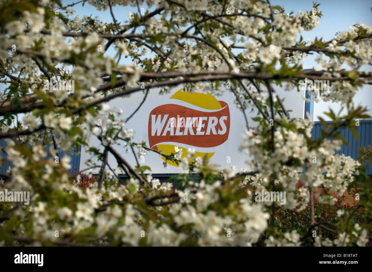 The Walkers Crisp snack food sign logo on the corporate factory and company headquarters HQ in Beaumont Leys Leicester - Stock Image
