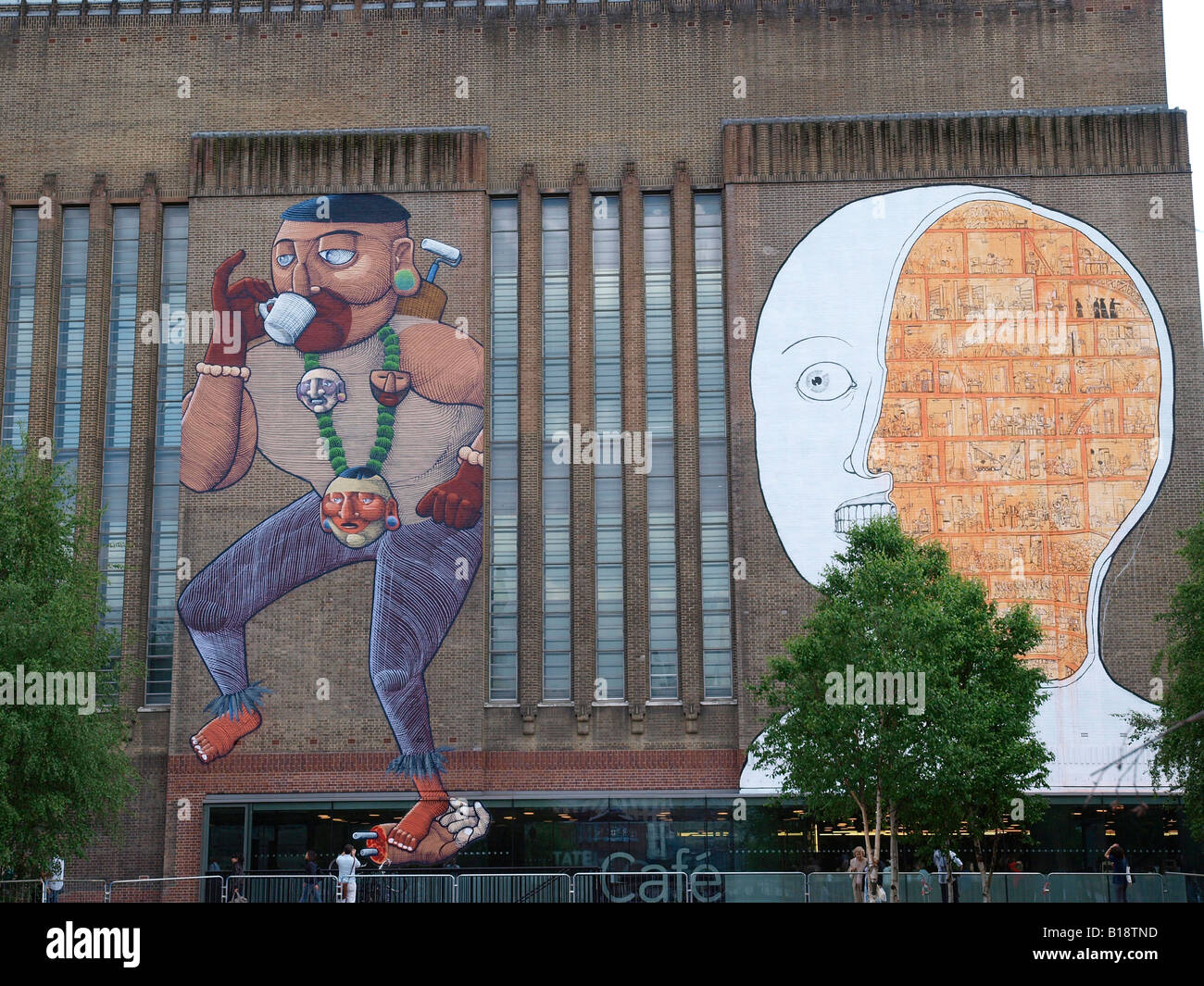 Graffiti art works by Nunca and Blu painted on the Tate Modern London - Stock Image