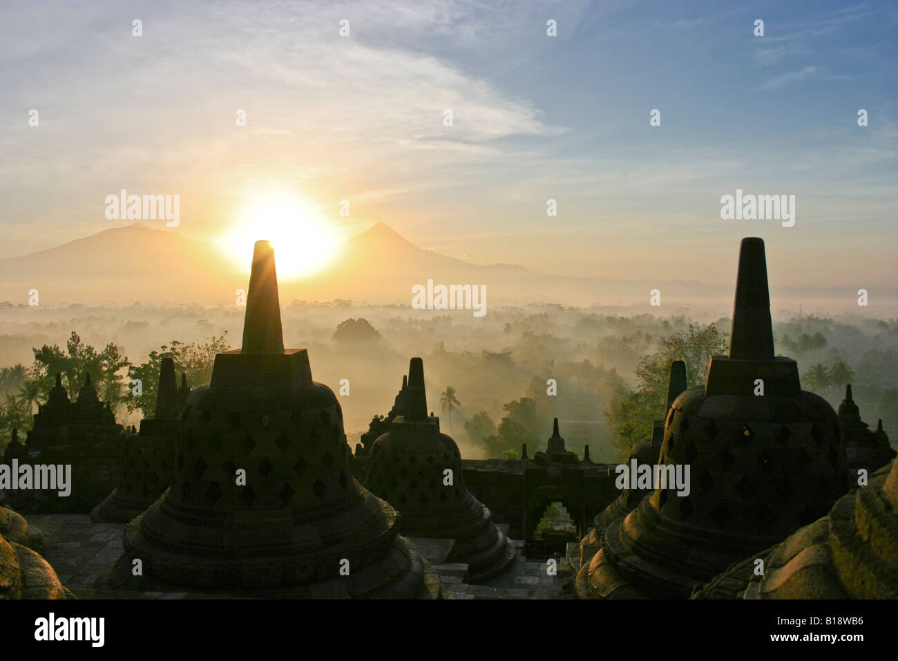 Sunrise view of the Merapi volcano from the top of the temple of Borobodur in Central Java - Stock Image